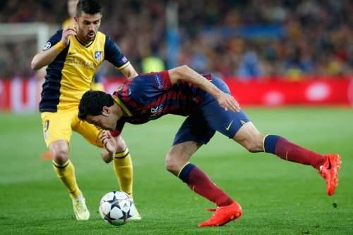 http://img02.mundodeportivo.com/2014/04/01/Barcelona-s-Sergio-Busquets-ri_54404630316_54115221152_960_640.jpg