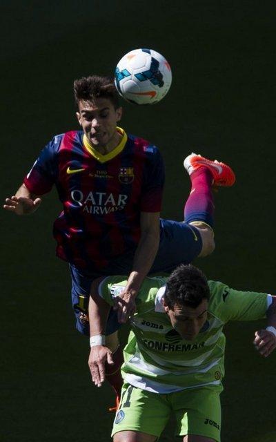 http://img02.mundodeportivo.com/2014/05/03/Lliga-Barcelona-Getafe-Foto-Pe_54406563463_54115221157_400_640.jpg