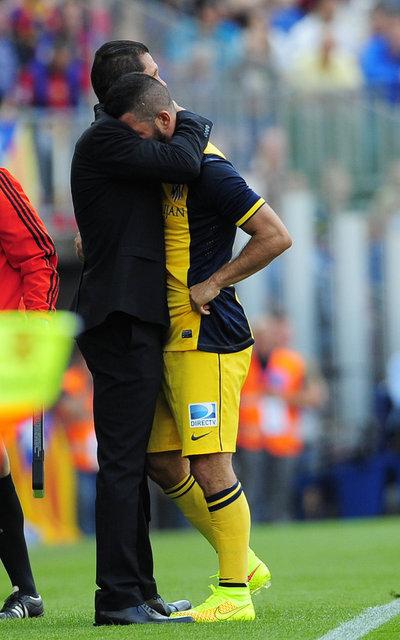 http://img02.mundodeportivo.com/2014/05/17/Atletico-s-coach-Diego-Simeone_54407019636_54115221157_400_640.jpg
